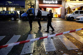 Police stand guard after cordoning off an area in central Paris as security operations continue in the wake of the Nov.13 terror attacks, in which at least 129 people were killed, Nov. 17, 2015.
