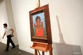 "Artist Frida Kahlo's painting ""Nina Con Collar"" sits on an easel at Sotheby's auction house in New York, Nov. 14, 2016. The painting sold for $1.81 mllion Tuesday, Nov. 22, 2016."