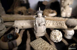 FILE - Ivory carvings seized by the U.K. Border Force at Heathrow Airport sit on display at Custom House near Heathrow in London, Britain, Nov. 22, 2017.