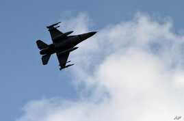 FILE - A Turkish fighter jet flies above the Incirlik airbase in southern Turkey, Aug. 31, 2013. Turkey on Tuesday launched a number of airstrikes against targets in Iraq and Syria.