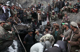 Afghans miners and local residents wait for news outside  a coal mine in Narin, Baghlan province, north of Kabul, Afghanistan, Saturday, Dec. 24, 2011. An Afghan official says 11 miners have died in an accident at thecoal mine in central Afghanistan.
