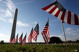 U.S. flags representing suicides of active and veteran members of the military line the National Mall, Oct. 3, 2018, in Washington. The suicide rate among female veterans is lower than that of male veterans, but female veterans are almost twice as li