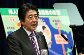 Japanese Prime Minister Shinzo Abe speaks during a press conference at his official residence in Tokyo, July 1, 2014.
