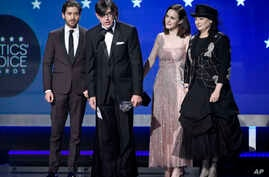 "Michael Zegen, from left, Daniel Palladino, Marin Hinkle, Rachel Brosnahan, and Amy Sherman-Palladino accepts the award for best comedy series for ""The Marvelous Mrs. Maisel"" at the 23rd annual Critics' Choice Awards at the Barker Hangar on Thursday,"