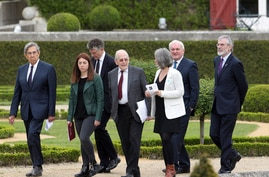 International mediators (from left to right) : Cuauhtemoc Cardenas, Agorria Quevas, Jonathan Powell, Michel Camdessus, Anais Funosas, Bertie Ahern and Gerry Adams walk towards the podium at the end of a peace conference held in Cambo-les-Bains, south
