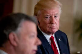 President Donald Trump, right, listens as Colombian President Juan Manuel Santos, left, speaks during a news conference in the East Room of the White House, in Washington, May 18, 2017.