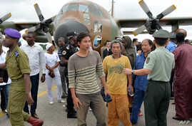Chinese and Cameroonian hostages, who were released to the Cameroonian authorities after being kidnapped in raids blamed on the Nigerian Islamist group Boko Haram, arrive in Yaounde, Oct. 11, 2014.
