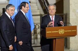 FILE - United Nations Secretary General Antonio Guterres arrives with Greek Cypriot President Nicos Anastasiades and Turkish Cypriot leader Mustafa Akinci, for a news conference after the Conference on Cyprus Peace Talks, at the European headquarters