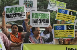 Pakistani human rights activists rally against disappearances of people on the International Day of the Victims of Enforced Disappearance in Lahore, Pakistan, Aug. 30, 2016.