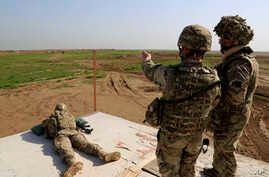FILE - American and Spanish trainers use live ammunition in training exercises at Basmaya base, 40 kilometers southeast of Baghdad, Iraq. Intelligence assessments approved by senior leaders at U.S. Central Command exaggerated the progress of anti-ter
