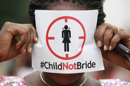 A woman protests underage marriages in Lagos, Nigeria, July 20, 2013. Underage marriage is a problem around the world. Activists are calling on former Soviet countries to overhaul laws against sexual violence and child marriage.