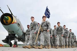 U.S. paratroopers after being flown into the air base in Swidwin, Poland for weeks of joint military exercises, April 23, 2014.