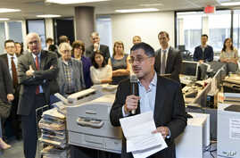 Reporters and editors gather in the The Washington Post newsroom in Washington, April 14, 2014, as contributing writer Barton Gellman describes the effort that went into a series of stories on the government's massive surveillance program based on in