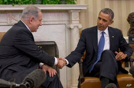 President Barack Obama and Israeli Prime Minister Benjamin Netanyahu shake hands during their meeting in the Oval Office of the White House in Washington, Monday, March 3, 2014.