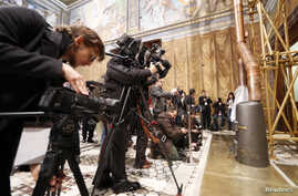 Media films the stove at the Sistine Chapel in the Vatican, Mar. 9, 2013.