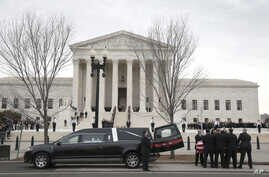 The body of Justice Antonin Scalia arrives at the Supreme Court in Washington, Feb. 19, 2016. Thousands of mourners will pay their respects Friday for Justice Antonin Scalia as his casket rests in the Great Hall of the Supreme Court.