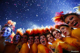 Performers pose after the end of closing ceremony of the London 2012 Olympic Games at the Olympic stadium August 12, 2012.