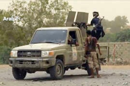 This still image taken from video provided by Arab 24 shows Saudi-led forces fighting to retake the international airport of Yemen's rebel-held port city of Hodeida from Shiite Houthi rebels, June 16, 2018.