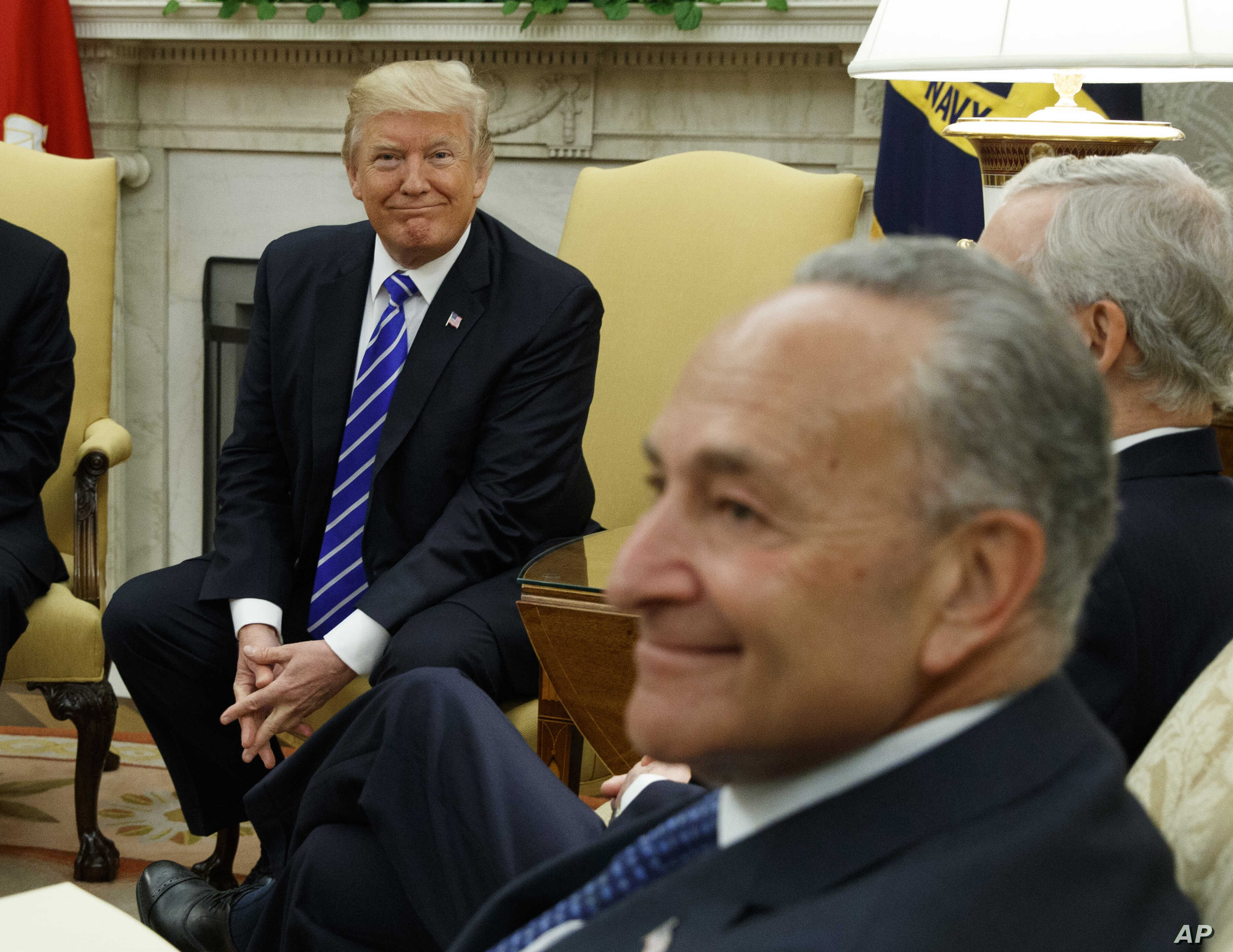 President Donald Trump and Senate Democratic Minority Leader Chuck Schumer are seen during a meeting with  other Congressional leaders in the Oval Office of the White House in Washington, Sept. 6, 2017.