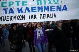 "Greek protesters march against government policies affecting pensioners in Athens, Greece, Dec. 15, 2016. The banner reads ""Bring back what you have stolen""."