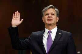 FBI Director nominee Christopher Wray is sworn-on on Capitol Hill in Washington, July 12, 2017, prior to testifying at his confirmation hearing before the Senate Judiciary Committee.