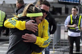 A woman is comforted by a man near a triage tent set up for the Boston Marathon after explosions went off at the 117th Boston Marathon in Boston, Massachusetts April 15, 2013.