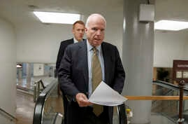 Senator John McCain, a member of the Senate Foreign Relations Committee, heads to the chamber to advance a bill providing $1 billion in loan guarantees to Ukraine, March 24, 2014.
