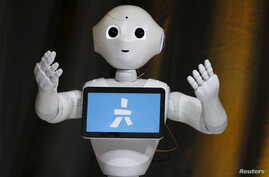 Pepper, an emotional Robot, greets conference attendees during the Wall Street Journal Digital Live (WSJDLive) conference at the Montage hotel in Laguna Beach, California October 20, 2015.