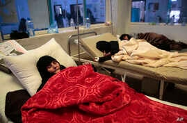 Women are treated for a suspected cholera infection at a hospital in Sanaa, Yemen, May. 15, 2017.