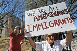 """Protesters chant outside the Grayson County courthouse in Sherman, Texas, Feb. 16, 2017. In an action called """"A Day Without Immigrants,"""" immigrants across the country are expected to stay home from school, work and close businesses to show how critic"""