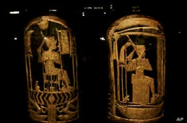 Ancient Egyptian shields made of wood covered with gesso and gold leaf are displayed in a glass case during the exhibition of Tutankhamun's unseen treasures marking the 115th anniversary of the Egyptian museum in Cairo, Egypt, Nov. 15, 2017.