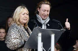 Cynthia Lennon and her son, Julian, appear at the unveiling of a European peace monument dedicated to the memory their husband and father, former Beatle John Lennon, in Chavasse Park, Liverpool, England, Oct. 9, 2010.
