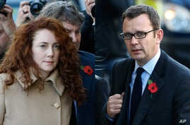 FILE - Former News of the World editor Rebekah Brooks and husband Charlie Brooks, left image, and former News of the World editor Andy Coulson arrive at The Old Bailey law court in London.