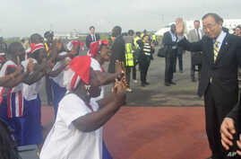 UN Secretary General Ban Ki-moon, is greeted by dancers upon arrival at the Roberts international airport in Monrovia, Liberia, Friday, Dec. 19, 2014.