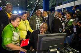Deputy President Cyril Ramaphosa, seated, and African National Congress party members discuss municipal election results at the results center in Pretoria, South Africa, Aug. 5, 2016.