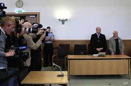 Siert Bruins , 92-year-old former member of the Nazi Waffen SS, right, and his lawyer Klaus-Peter Kniffke, in court, Hagen, Germany, Sept. 2, 2013.