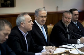 Israeli Prime Minister Benjamin Netanyahu listens during a weekly cabinet meeting in Jerusalem, Jan. 18, 2015.