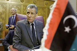Libyan representative Ashour Abu-Rashed attends an emergency meeting to discuss the conflict in Libya, at the Arab League headquarters in Cairo, Jan. 5, 2015.