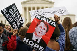 "Protesters gather in front of the Supreme Court holding signs with the image of Judge Brett Kavanaugh that read ""Kava Nope"" and ""We Believe Christine Blasey Ford"" on Capitol Hill in Washington, Sept. 24, 2018."