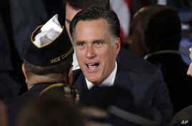 Republican presidential candidate, former Massachusetts Gov. Mitt Romney greets veterans as he campaigns at American Legion Post 176 in Springfield, Virginia, September 27, 2012.