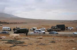 A photo released by the Syrian official news agency SANA shows Syrian government forces taking up positions in Palmyra before retaing the ancient city from Islamic State group militants, near Homs, Syria, March 2, 2017.