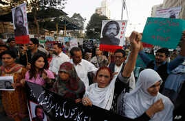 Activists of Pakistan civil society rally to condemn the missing of human rights activist Salman Haider, in Karachi, Pakistan, Jan. 9, 2017.