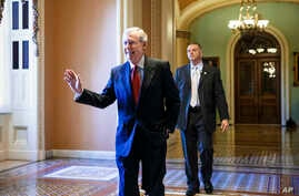 Senate Minority Leader Mitch McConnell walks to his office on Capitol Hill, Nov 12, 2014.
