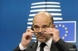 European Commissioner for economics, taxation and customs Pierre Moscovici attends a press conference after an Euro zone finance ministers meeting in Brussels, Dec. 8, 2014.