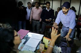 Uber's General Manager for Delhi region Gagan Bhatia speaks to the Chairperson of Delhi Commission for Women Barkha Singh after being summoned by the commission in New Delhi, India, Tuesday, Dec. 9, 2014.