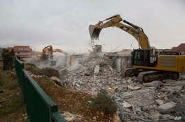 Bulldozers demolish houses in the West Bank settlement of Ofra, March 1, 2017.