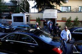 Officials leave Saudi Arabia's consulate in Istanbul, Turkey, Oct. 7, 2018.