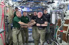 NASA astronauts Scott Kelly (R) and Tim Kopra shake hands as Kelly turns over command of the International Space Station to Kopra, February 29, 2016.