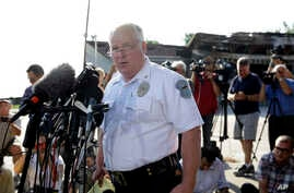 FILE - Ferguson Police Chief Thomas Jackson releases the name of the the officer accused of fatally shooting an unarmed black teenager Friday, Aug. 15, 2014.