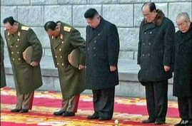 North Korea's new leader Kim Jong Un (C) bows during the funeral of late North Korean leader Kim Jong Il in this still image taken from video, in Pyongyang, December 28, 2011.